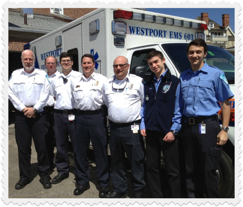 EMS volunteers and paramedics (from left) Larry Kleman, Yves Cantin, Kevin Doherty, Marc Hartog, Rich Baumblatt, Joe Pravder and Aaron Greenspun stand ready, outside the ambulance garage behind the headquarters they share with Westport police.