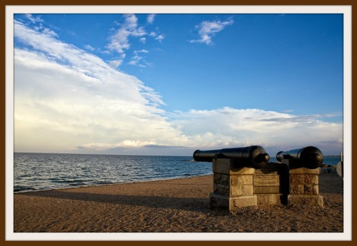 Today, skies were clear. And the Compo cannons stand ready for another summer of beachgoers.  (Photo/Katherine Hooper)