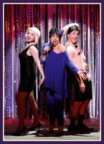 """This """"Cabaret Revival"""" sketch includes Carter Calvert as Liza Minelli, Mia Gentile as Michelle Williams playing Sally Bowles, and Scott Foster as Alan Cumming (the MC)."""