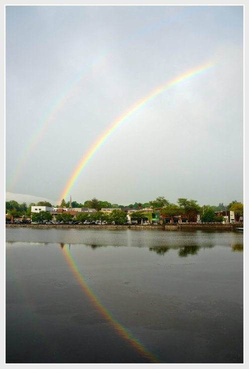 Meanwhile, the Bartaco crowd was treated to this rainbow over downtown -- and its reflection in the river. (Photo/Katherine Hooper)