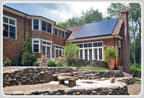 This Westport home was retrofitted with a 5 kW solar system using 225 watt solar panels. It won an award -- but is it cost-efficient? (Photo courtesy of SunPower)