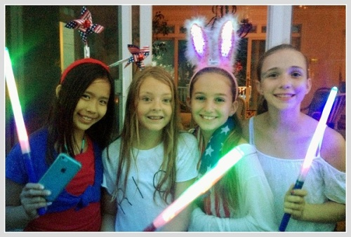 Cute little girls create a great light show.