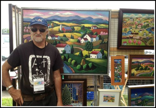 One of 130 artists shows off his work.