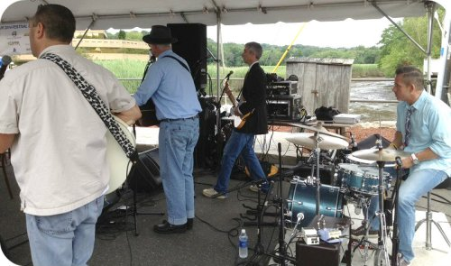 What's an arts festival without music. Bands play under a tent, next to the Saugatuck River.