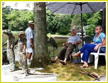 Artists relax near the work on Gorham Island, in 2009.