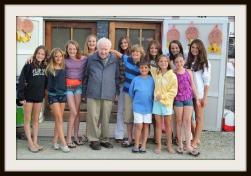 Jack Donovan, surrounded by his 12 grandchildren.