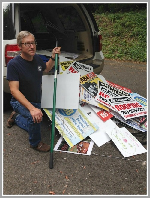 Al Gratrix with some of the illegal signs.