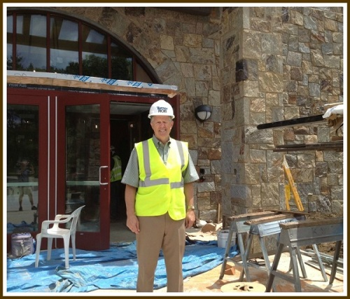 Westport Y CEO Rob Reeves stands proudly by the nearly completed front entrance.