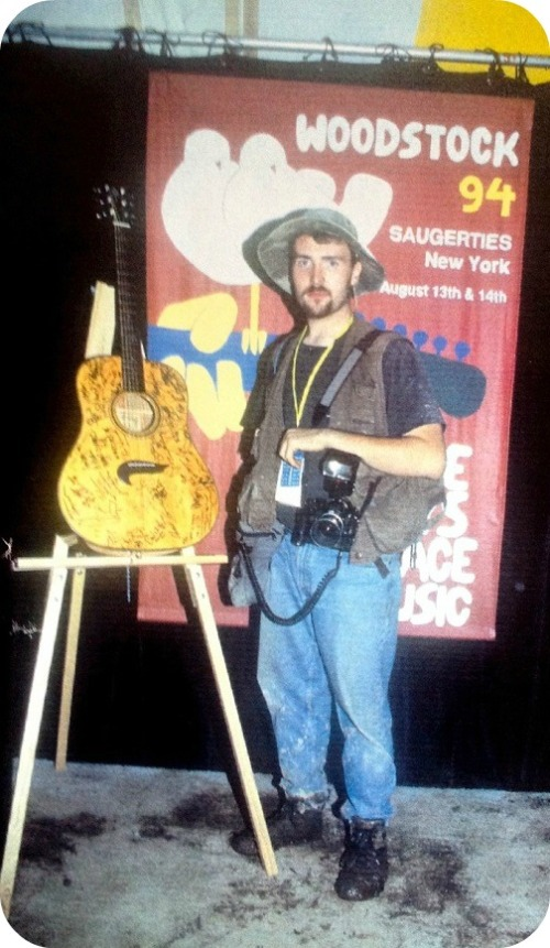 JP Vellotti, in front of a guitar signed by all the Woodstock 94 performers. (Photo/Joe Sia)