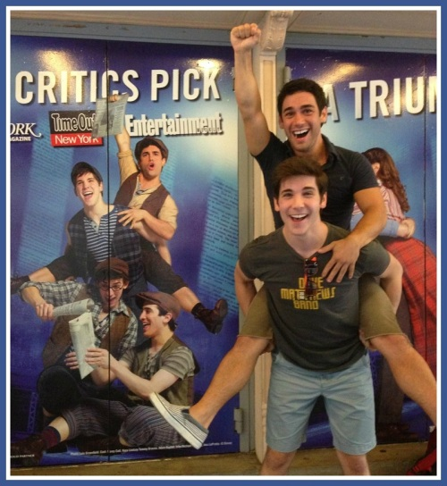 Adam Kaplan (carrying a fellow actor on his back) strikes the same pose as shown on the Nederlander Theater door. This shot was taken the day the poster went up.
