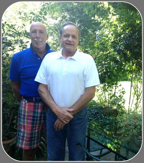 John DeLibero (left) and Ron Johnson in the back yard of their Westfair Village home.