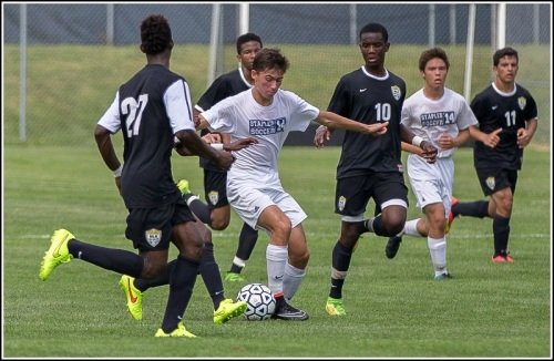 Staples soccer players, including Nate Argosh (left) and Kenji Goto, played against New York City powerhouse Martin Luther King HS. (Photo/Kim Lake).