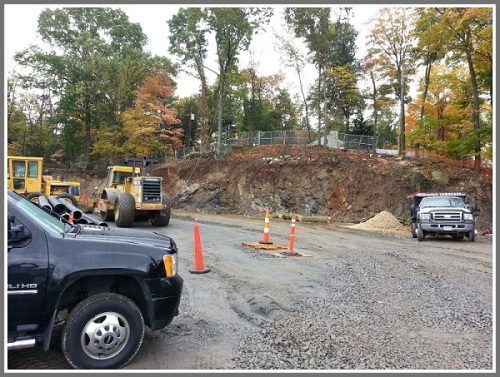 Excavation work behind Compo Acres Shopping Center.