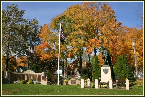 Plaques, memorials and a statue fill Westport's Veterans Green, across from Town Hall.