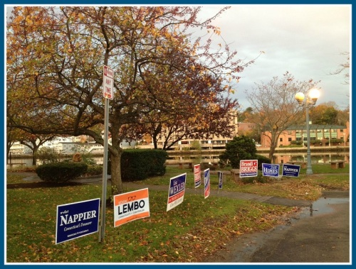 Both the sun and Election Day signs were up early this morning, at the Westport Library polling place.