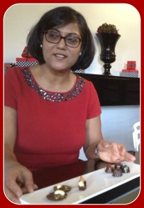 Aarti Khosla, in her red-and-black-themed chocolate shop.