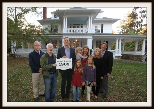 Nico Eisenberger (3rd from left) and his wife Robin Bates (holding child) accept a Westport Historical Society plaque designating their house as dating to 1903 from Bob Weingarten. At the ceremony were the couple's 3 children, and Peter Jennings (far left), an 11th-generation Westporter and descendant of original owner Henry Jennings. (Photo/Dave Matlow, courtesy of WestportNow)