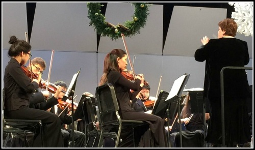 Adele Valovich leads the symphonic orchestra.