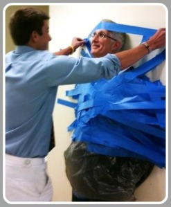 John Dodig goes to great lengths to show his love for Staples. A few years ago, golf captain Dylan Murray duct-taped his principal to the wall, for a fundraiser.