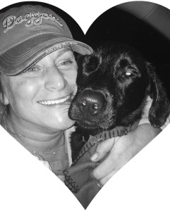 Amy Scarella, and one of her black dogs.