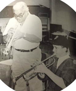 Jack Adams teaches -- and plays with -- Staples freshman Ryan Price, in 1992.