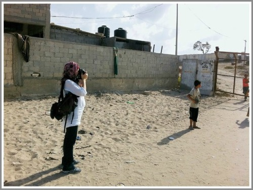 Lynsey Addario was 27 months pregnant in October 2010, when she photographed children in the Gaza Strip. (Photo/New York Times)