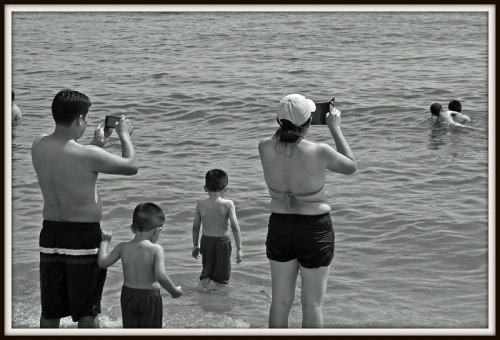 """""""Couple Photographing Children in Water"""" -- Larry Silver, 2014."""
