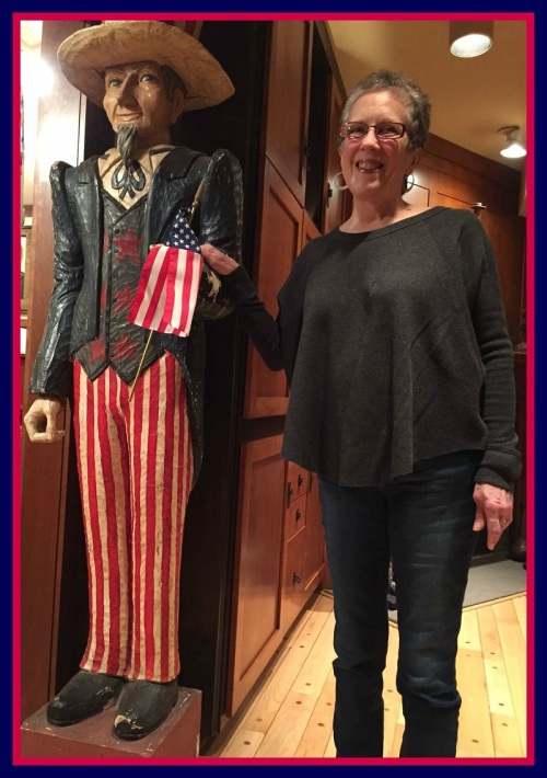 Anne Levine stands with a life-size carving of Uncle Sam.