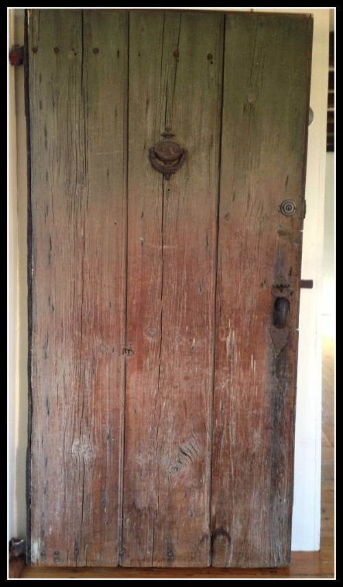 The door today. The hole left by the missing musket ball can be seen on the left side, underneath the knocker.