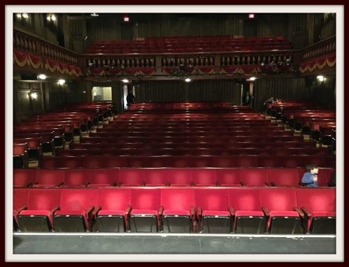 A decade ago, the Westport Country Playhouse replaced its bench seating with individual seats. But they're still red. Some things never change.