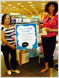 Bassick parent Joanne Kennedy (left) and parent center worker Kizzie Gibson promote tomorrow's Barnes & Noble Book Fair.