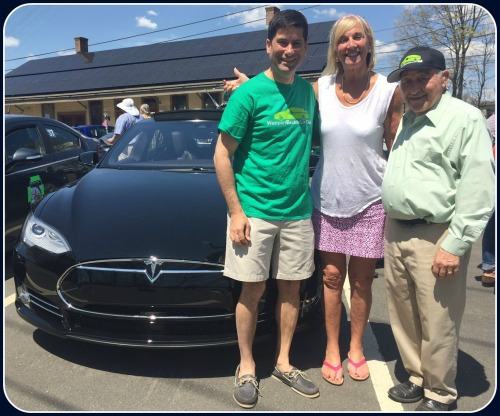 Robin Tauck (center) lent selectmen  Jim Marpe and Avi Kaner (left) her 2 electric vehicles last year. Kaner liked driving it so much, he bought this Tesla P35D model. It goes from 0 to 60 in 3.1 seconds -- not that anyone does that on local roads. On the right is Westport Electric Car Club president Leo Cirino.