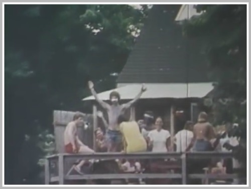 ...and partying at a house on the river, as the racers go by.