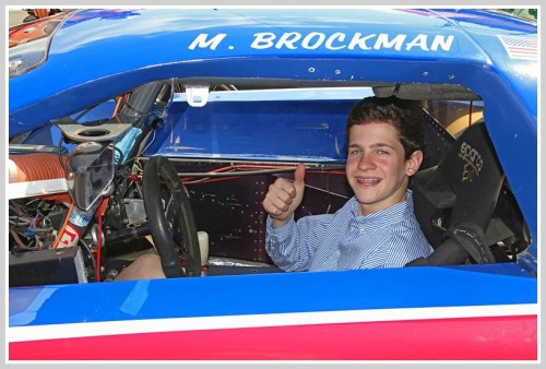 Spencer Brockman in a racing Camaro's driver's seat. The car -- originally co-owned by his father and Paul Newman -- is now co-owned by Michael and Spencer. (Photo/Lynn U. Miller)