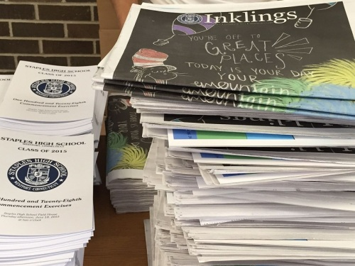 Plenty of reading material for early arrivals: the graduation program, and the year-end issue of Inklings.