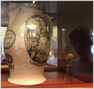 Bob Custer (seen reflected at right) shows off a pitcher given to the church by Martha Washington. It honors Rev. Hezekiah Ripley, who served from 1762 to 1821.