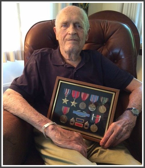 Bob Loomis proudly displays some of his medals. Tomorrow, he'll add the Croix de Guerre.