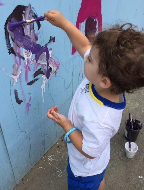 This little boy was so intent on his creation, he couldn't stop to give his name.