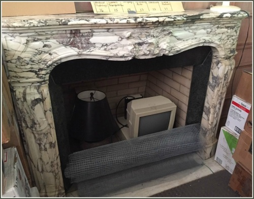 Yes, that's an old computer monitor being stored inside the Italian marble fireplace.