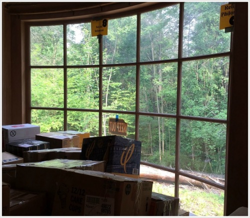 A bay window looks out over a beautiful dell.