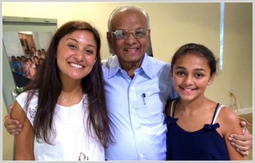 Maddy (left) and Maya Sampath, with their grandfather T. Sampath Kumar.