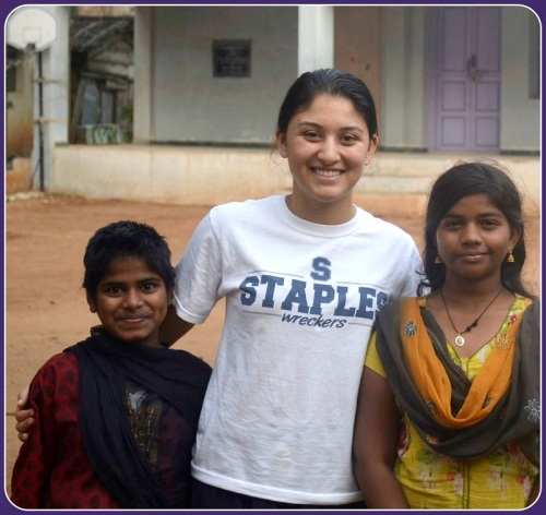 Maddy Sampath (center), with 2 girls from the orphanage in India.