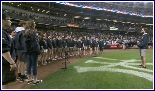 Choral director Luke Rosenberg directs the Orphenians at Yankee Stadium. (Photo/New York Yankees)