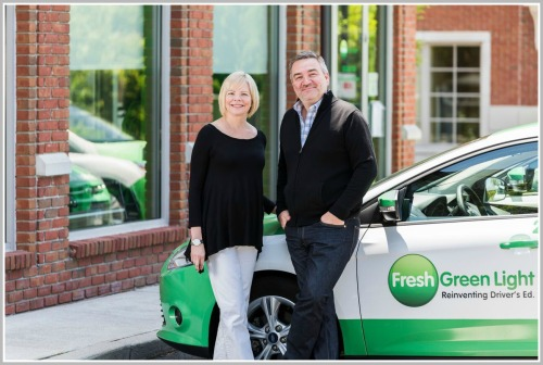 Steve Mochel and Laura Shuler, with a Fresh Green Light car.