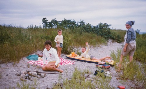 Bill Whitbeck's sister Joanne, neighbor Bobby Bittner, Bill (waving) and his mom, at the highest area of the sandbar. 1958.