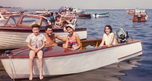 Bill Whitbeck, his sister's fiance, and 2 sisters on the 16-foot outboard his father built. This was its maiden voyage. It was so new, he had not yet installed the windshield. The photo was taken inside Cockenoe's bay, a perfect anchorage, surrounded by the island's horseshoe shape. Check out the wooden boats -- there was no fiberglass in 1959.
