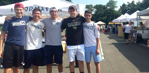 Staples soccer players (from left) Sebastian Wick, Kenji Goto, Noah Schwaeber, Graham Gudis and Timmy Liles get ready to volunteer at the Westport Farmers' Market. Matteo Broccolo and Daniel Brill were also there, working elsewhere.
