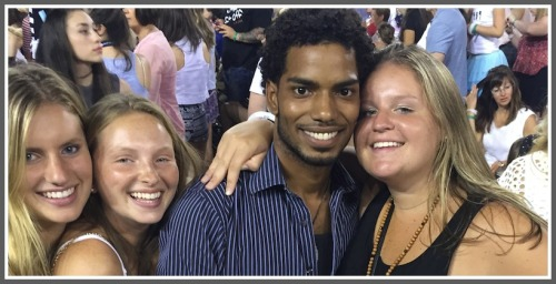Jenna McNicholas, Jamie Tanzer and Maggie Fair with their new friend, Khalil Calixte.