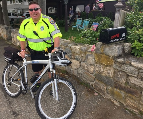 Police patrolled on foot, motorcycles -- and bikes. Ned Batlin was stopped everywhere by students, who know him from DARE programs and coaching.