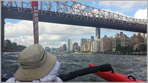 Aaron and Susan Donovan approaching the 59th Street Bridge (feelin' groovy). The UN is in the distance.